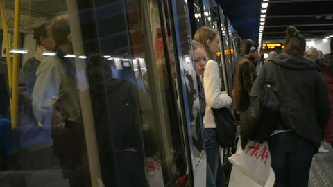 People leaving the train in underground Footage