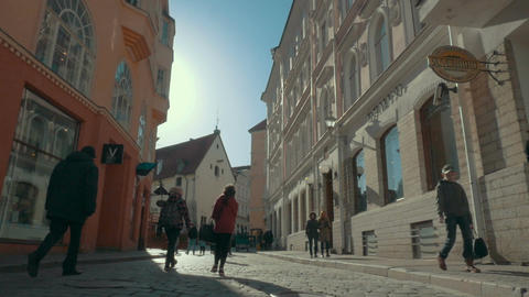 European street with walking people on sunny day Footage
