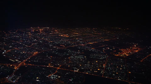 Aerial view on Dubai city from airplane at night Footage