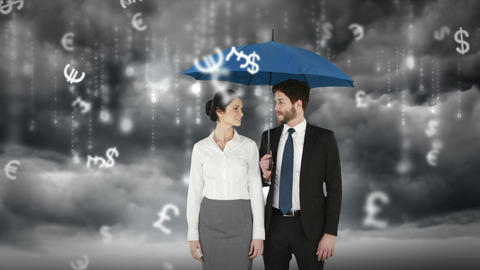 Composite image of businessman and businesswoman holding an umbrella Footage