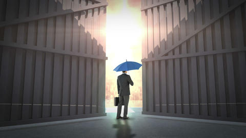 rear view of businessman holding umbrella Live Action