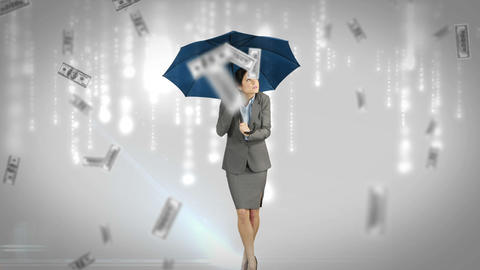 Businesswoman standing under umbrella Footage