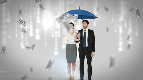 Business people standing under umbrella Footage