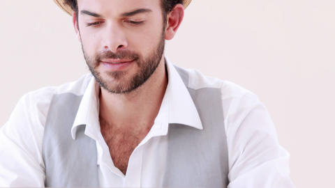 Happy hipster businessman using his computer Footage