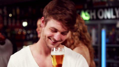 Smiling man toasting with beer Footage