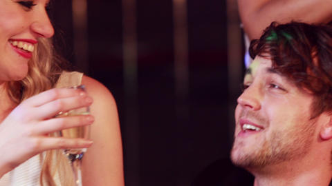 Smiling couples drinking champagne Footage