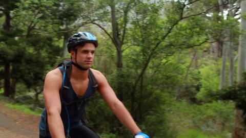 Couple biking through a forest Footage