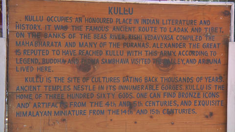 Wooden Sign Board With Inscription Telling History Of Kullu Town, India stock footage