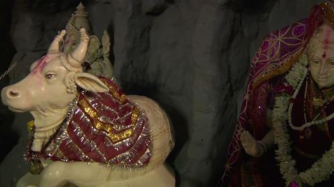 Ceramic Statues of Hindu God Nandi and Goddess Parvathi in Shiva Temple. Bangalo Footage