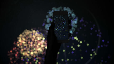 Silhouette of hand recording fireworks with smartphone Live Action