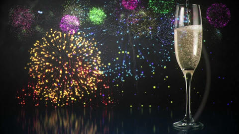 Glass of champagne with fireworks on background Live Action