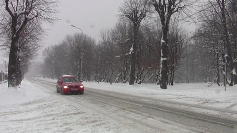 Vehicles traveling on a road that is not cleaned of snow 73 Footage