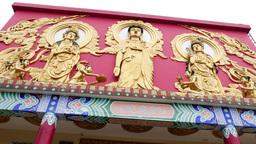 Buddhist fresco on the sanctuary facade, golden bas-relief on red wall Footage