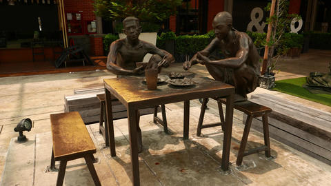 Bronze composition of dockers eating, camera move around Footage