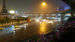 Victory Monument and Phayathai road night rainy view, Skytrain elevated railway Footage