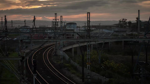 Time-lapse in Durban, South Africa of train railroad industrial factories Sunset Footage