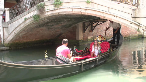 Gondola passing by in a canal in Venice Italy Footage