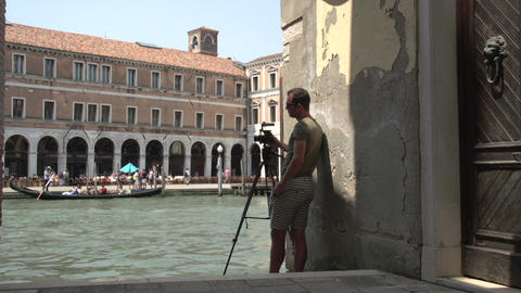 Cameraman takes picture from gondolas in front of Campo Erberia Footage