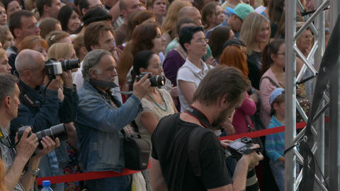 Ungraded: Photographers Take Pictures of Stage During Performance in The Footage