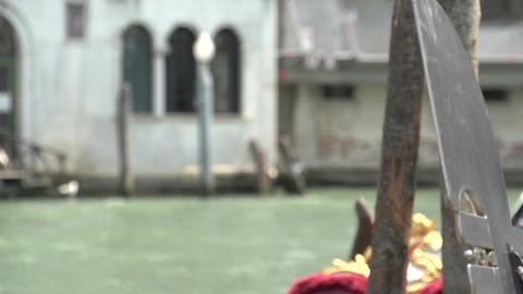 Gondolas waiting for tourists in canal of Venice, close up Footage