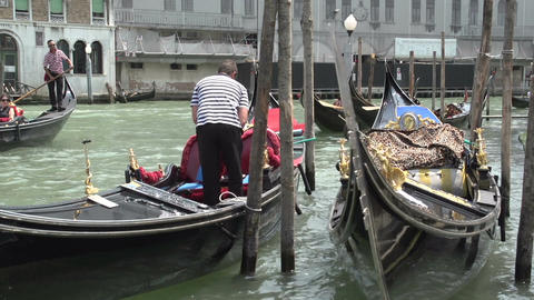Gondolas waiting for tourists in canal of Venice Footage