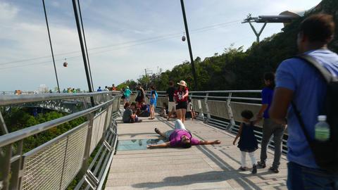Crowded Sky Bridge, struggle through tourists swarm on narrow curved Footage