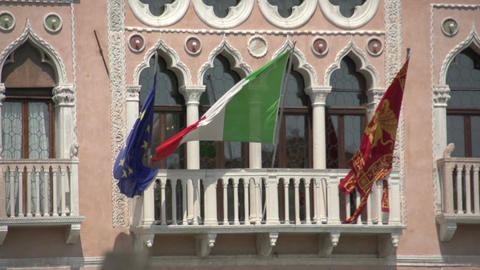 Italian, Venetian and European flag in slow motion on house in Venice Footage