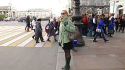Girl stand against people crossing road, look around Footage
