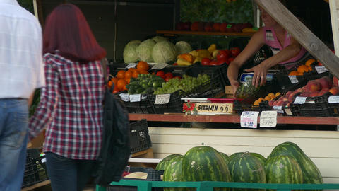 4K Ungraded: Seller Arranges Fruit Stall Summer Day Outdoors Footage