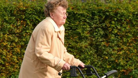 pensioner wheel walker in autumn park side close 4k 11771 Live Action