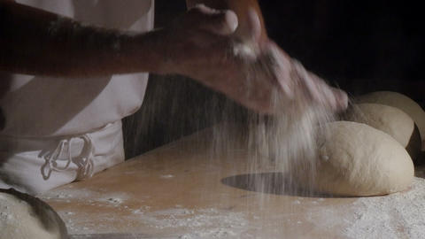 baker clapping with flour powder in hands spotlight 11773 Footage
