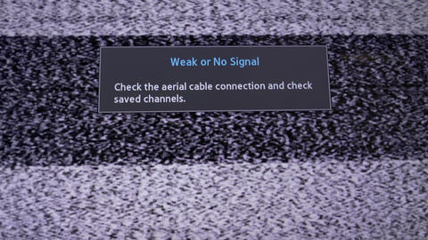 "4K Ungraded: LCD Television Set Displays Static Noise and Message ""Weak or No Footage"
