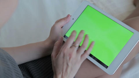 Woman watch on green screen tablet computer closeup. The concept of buying Chris Footage