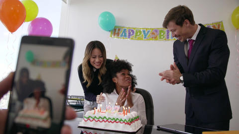 4 Business People Celebrating Colleague Birthday Party In Office GIF