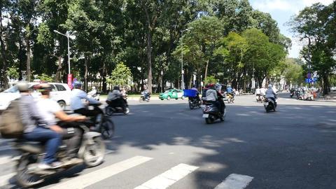 HO CHI MINH / SAIGON, VIETNAM - 2015: Streets busy asian city life slow motion Footage