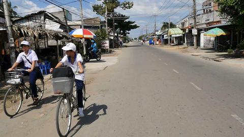 MEKONG DELTA, VIETNAM - 2015: School boy on bike riding home village lifestyle Footage