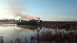 Double headed steam freight train crosses lake Footage