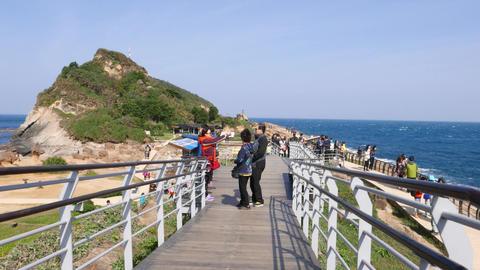 POV walk along Yehliu Geopark gangway, asian tourist at windy path Footage
