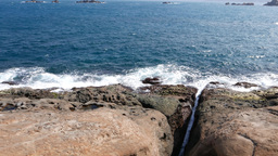 Rock hard shore and waves of East China Sea, Crack in rock made by water Footage