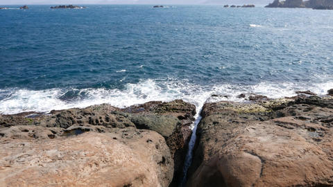 Rock hard shore and waves of East China Sea, Crack in... Stock Video Footage