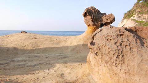 Mushroom rock, hoodoo stone on deserted shore, odd nature creation Footage