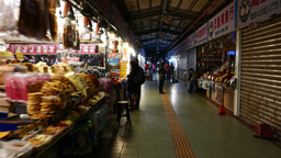 End of workday indoor market, souvenirs and snacks stalls, half closed Footage