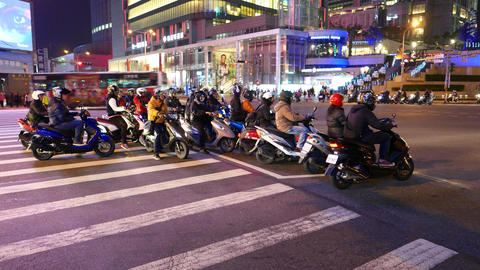 Motorbikes mob on crossroad, busy intersection. Starting on green light Footage