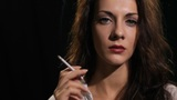 woman smokes cigarette Footage