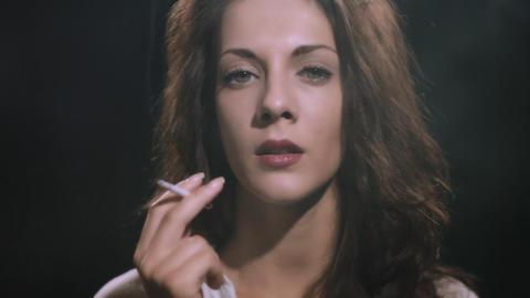 woman smokes cigarette Stock Video Footage