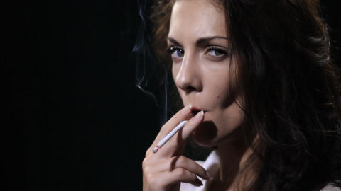 woman smokes cigarette Stock Video Footage