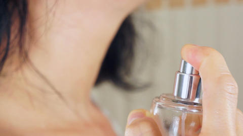 Woman Spritzing Perfume on Her Neck Stock Video Footage