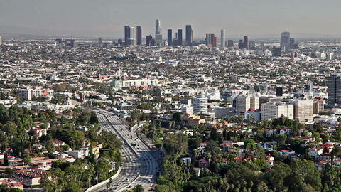 Los Angeles city view with traffic on freeway Stock Video Footage