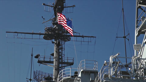 USA flag and antennas on carrier control tower in blue sky Stock Video Footage