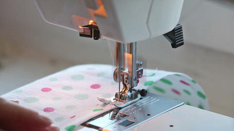 Closeup view of girl sewing on machine Stock Video Footage
